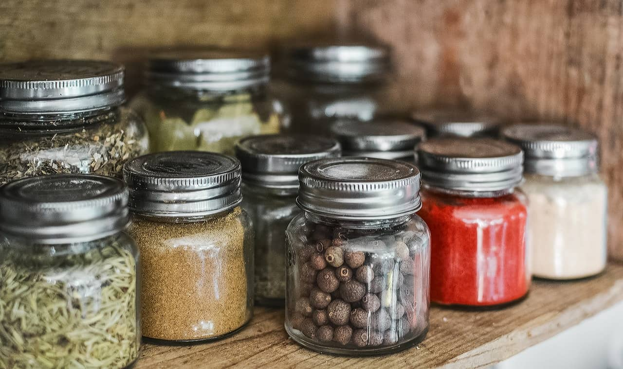herbs and seeds in jars